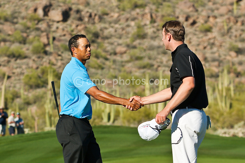 Feb 25, 2009; Marana, AZ, USA; Tiger Woods (USA) shakes hands with Brendan Jones (AUS) after winning their match 3 and 2 in the first round of the World Golf Championships-Accenture Match Play Championship at the Ritz-Carlton Golf Club, Dove Mountain.
