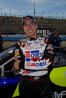 Apr 20, 2006; Phoenix, AZ, USA; Nascar Nextel Cup racer Kyle Busch driver of the (5) Kelloggs/Carquest Chevrolet Monte Carlo smiles after qualifying on the pole for the Nextel Cup Subway Fresh 500 at Phoenix International Raceway. Mandatory Credit: Mark J. Rebilas-US PRESSWIRE Copyright © 2006 Mark J. Rebilas..