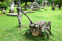 "One of the quirkiest, yet most interesting attractions in Vientiane would have to be Xieng Khuan, commonly called ""Buddha Park"". Xieng Khuan or ""Spirit City"" is just as much a monument to one man's eccentric and bizarre ambition as it is an impressive collection of massive ferro-concrete sculptures dotted around a riverside meadow. Although the brontosaurian reclining Buddha and strange edifice resembling a pumpkin - there are statues of every conceivable deity in the Buddhist/Hindu pantheon. Even if you are not up on your Buddhist/Hindu deities you will enjoy strolling around some of the more fantastic shapes.  Xieng Khuan was designed and built in 1958 by Louang Pou Bunleua Sulilat a self style holy man who took Hinduism and Buddhism and merged them into his own iconography. After the revolution in 1975, he fled from Laos to Thailand where he built another sculpture park, Sala Keoku in Nong Khai.. He fled because his anti-Communist beliefs conflicted with the views of the Pathet Lao."
