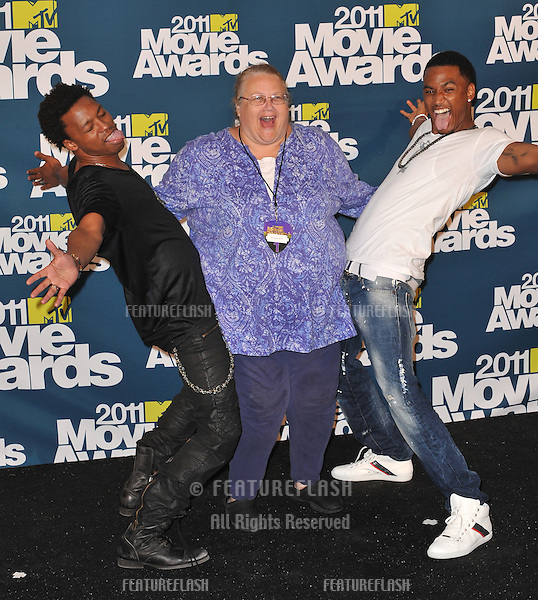 Lupe Fiasco (left) & Trey Songz with photographer Kathy Hutchins at the 2011 MTV Movie Awards at the Gibson Amphitheatre, Universal Studios, Hollywood..June 5, 2011  Los Angeles, CA.Picture: Paul Smith / Featureflash
