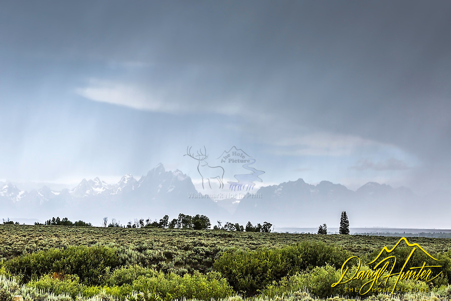 Jackson Hole thunderstorm, a promise of sun beyond.  The hole in the storm reveals the jagged peaks of the Grand Tetons in Grand Teton National Park