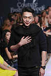 Indonesian fashion designer Geraldus Sugeng walks runway with models at the close of his Geraldus Sugeng collection fashion show for Couture Fashion Week Spring 2018 at the Crowne Plaza Times Square in Manhattan, on September 8, 2017; during New York Fashion Week.