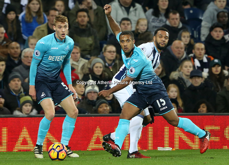 Wayne Routledge of Swansea City FC wins possession of the ball and crosses it into the box during the Premier League match between West Bromwich Albion and Swansea City at The Hawthorns, England, UK. Wednesday 14 December 2016