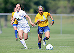 BROOKINGS, SD - SEPTEMBER 7:  Shelby Raper #4 from South Dakota State drives with the ball past Grace Ogden #29 from Bemidji State in the first half of their game Sunday in Brookings. (Photo/Dave Eggen/Inertia)