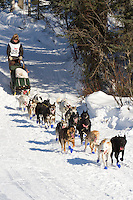 Musher Heather Siirtola on Long Lake at the Re-Start of the 2011 Iditarod Sled Dog Race in Willow, Alaska.