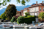 Boats and colorful houses in the town of Sala Comacina on Lake Como, Italy
