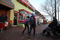 (171128RREI2300) Carlos Munoz, wheel chair bound, at La Esquina where Latinos have gathered for decades at the corner of Mt. Pleasant St. and Kenyon St. NW. to play checkers (damas). Washington DC.  Nov. 28 ,2017 . ©  Rick Reinhard  2017     email   rick@rickreinhard.com