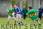 TJ Heaphy Kerins O'Rahillys in action against Martin Loucher John Mitchels at Feile na Peil at Strand Road on Friday.