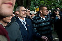 Sandor Pinter (3rd L) minister of internal affiars surrounded by bodyguards attends an anti-government rally of firemen and other law enforcement workers who protest in front of the Parliament against the government's austerity measures in Budapest, Hungary on May 06, 2011..The government has launched a package of fiscal reforms to cut the budget deficit, including scrapping early retirement, which mostly affects law enforcement personnel. ATTILA VOLGYI