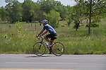 Man riding bike on ruralroad in Boulder, Colorado .  John leads private photo tours in Boulder and throughout Colorado. Year-round.