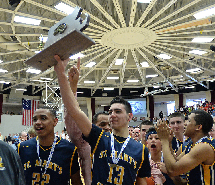 (Springfield, MA, 03/19/16) Members of the St. Mary's High School basketball team celebrate their Boys Division 4 state championship win over Maynard at Springfield College on Saturday, March 19, 2016. Staff photo by Christopher Evans
