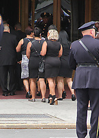 NEW YORK, NY - JULY 11: Mourners entering the church at the funeral of slain New York City Police Officer Miosotis Familia held at World Changers Church New York in Bronx,  New York on July 11, 2017.  Photo Credit: Rainmaker Photo/MediaPunch