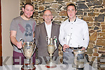 CUPS: Capt of Ballyduff victorous team2012 Aiden Boyle, Nicky Leen (Chairman) and Paul Costello (who was the Christy Ring All Star Player) who were at the Ballyduff Buffet in Lowes bar Ballyduff on Saturday night.