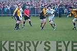 Ballyduffs Barry OGrady tries to shield the ball from the predatory presence of Listowel Emmets Tadhg Kennelly in their North Kerry football final clash at Moyvane on St Stephens Day.