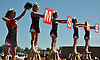 The Mount Sinai varsity cheerleading squad entertains the fans during a Suffolk County Division IV football game against Babylon at Islip High School on Saturday, September 5, 2015.<br />