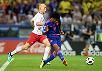 KAZAN - RUSIA, 24-06-2018: Juan CUADRADO jugador de Colombia dispara para anotar un gol a Polonia durante partido de la primera fase, Grupo H, por la Copa Mundial de la FIFA Rusia 2018 jugado en el estadio Kazan Arena en Kazán, Rusia. /  Juan CUADRADO player of Colombia shoots to score a goal to Polonia during match of the first phase, Group H, for the  FIFA World Cup Russia 2018 played at Kazan Arena stadium in Kazan, Russia. Photo: VizzorImage / Julian Medina / Cont