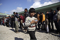 Pictured: A young boy having just been given food Friday 26 February 2016<br /> Re: Hundreds of refugees have been given temporary shelter at the Stefanakis Army Camp in the Schisto area of Athens, Greece.