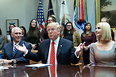 United States President Donald J. Trump speaks from the White House in Washington, DC during a congratulatory call to NASA astronauts Jessica Meir and Christina Koch after they conducted the first all-female spacewalk outside of the International Space Station on Friday, October 18, 2019.  With Trump are US Vice President Mike Pence (L), First Daughter and Advisor to the President Ivanka Trump. <br /> Credit: Chris Kleponis / Pool via CNP