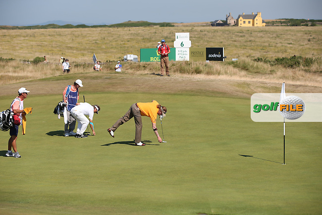 Miguel Angel Jimenez (ESP) will birdie the 5th during Round Two of the 2014 Senior Open Championship presented by Rolex from Royal Porthcawl Golf Club, Porthcawl, Wales. Picture:  David Lloyd / www.golffile.ie