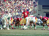 Washington Redskins quarterback Sonny Jurgensen (9) calls signals as he prepares to take the snap from center Len Hauss (56) during the game against the Miami Dolphins at RFK Stadium in Washington, DC on October 13, 1974.  Also pictured are Dolphins middle linebacker Nick Buoniconti (85) Dolphins right defensive end Bill Stanfill (84), and Redskins left tackle Ray Schoenke (62). The Redskins won the game 20 - 17.<br /> Credit: Arnie Sachs / CNP
