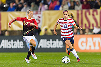Alex Morgan (13) of the United States (USA) is marked by Lena Goessling (20) of Germany (GER). The United States (USA) and Germany (GER) played to a 2-2 tie during an international friendly at Rentschler Field in East Hartford, CT, on October 23, 2012.