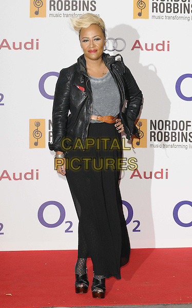 Emeli Sande.The Nordoff Robbins O2 Silver Clef Awards 2012, London Hilton Park Lane Hotel, London, England..June 29th, 2012.full length black skirt top leather jacket brown belt grey gray hand on hip   .CAP/CAN.©Can Nguyen/Capital Pictures.