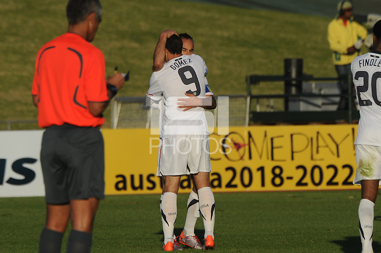 Landon Donovan congratulates Hercules Gomez on his goal in the third minute of stoppage time. The U.S. won the match over Australia, 3-1, played June 5th, in Ruimsig Stadium,  at Roodepoort, South Africa.