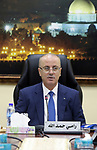 Palestinian Prime Minister Rami hamadallah chairs the Palestinian council meeting in the West Bank city of Ramallah on July 11, 2017. Photo by Prime Minister Office