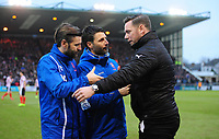 Lincoln City's assistant manager Nicky Cowley, left, and Lincoln City manager Danny Cowley, centre, shake hands with Notts County manager Kevin Nolan before kick off<br /> <br /> Photographer Chris Vaughan/CameraSport<br /> <br /> The EFL Sky Bet League Two - Lincoln City v Notts County - Saturday 13th January 2018 - Sincil Bank - Lincoln<br /> <br /> World Copyright &copy; 2018 CameraSport. All rights reserved. 43 Linden Ave. Countesthorpe. Leicester. England. LE8 5PG - Tel: +44 (0) 116 277 4147 - admin@camerasport.com - www.camerasport.com