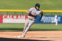Salt River Rafters left fielder Sam Hilliard (14), of the Colorado Rockies organization, rounds third base during an Arizona Fall League game against the Mesa Solar Sox at Sloan Park on October 30, 2018 in Mesa, Arizona. Salt River defeated Mesa 14-4 . (Zachary Lucy/Four Seam Images)
