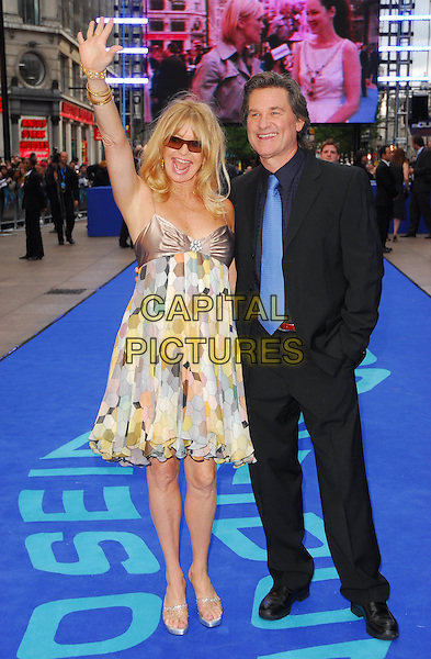 "GOLDIE HAWN & KURT RUSSELL.At the UK Film Premiere of ""Poseidon"", .Empire Leicester Square, London, .May 28th 2006..full length couple sunglasses patterned print dress babydoll chiffon satin gold bracelets platform shoes waving hand armpit.Ref: CAN.www.capitalpictures.com.sales@capitalpictures.com.©Can Nguyen/Capital Pictures"