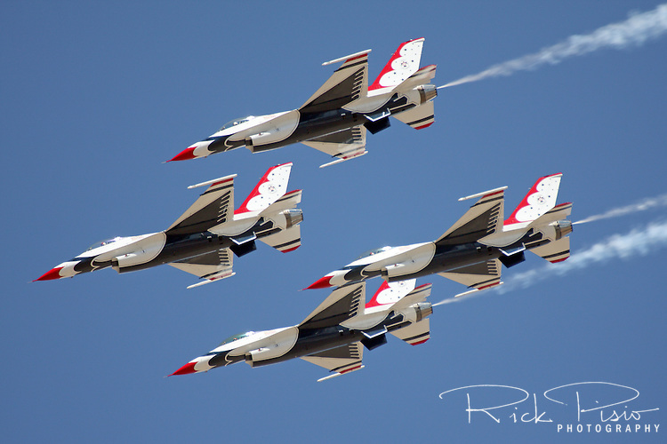 Four F-16C Fighting Falcons of United States Air Force Thunderbirds complete loop in diamond formation during the 2008 Reno National Championship Air Races at Stead Field in Nevada. The Thunderbirds were formed in 1956 and have been flying the F-16C Fighting Falcon since 1992.