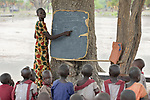 A teacher points to letters on a blackboard as she helps children learn the alphabet in the Loreto Primary School in Rumbek, South Sudan. The Loreto Sisters began a secondary school for girls in 2008, with students from throughout the country, but soon after added a primary in response to local community demands.