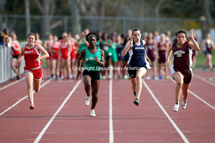 Walcott, CT- 05 May 2015-050515CM08- Sprinters from Wolcott, Wilby, Oxford and Naugatuck battle it out to the finish line during the girls 100m dash at Wolcott on Tuesday afternoon.  Naugatuck's Ariana Alvarado, far right, won the event.   Christopher Massa Republican-American