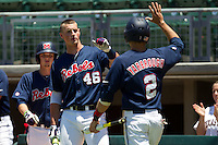 John Gatlin #46 of the Ole Miss Rebels greets teammate Alex Yarbrough #2 after he scored a run during the NCAA Regional baseball game against the Texas Christian University Horned Frogs on June 1, 2012 at Blue Bell Park in College Station, Texas. Ole Miss defeated TCU 6-2. (Andrew Woolley/Four Seam Images).