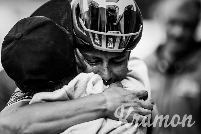 An emotional Esteban Chaves (COL/Mitchelton-Scott) hugs his dad after finishing 2nd in stage 17.<br /> Although we know him for his ever-charming smile, after being diagnosed with Epstein-Barr virus in 2018 and being off the bike for most of that season, the return to the main stage of Chaves has also been a tough journey back to finding/being himself. With his parents & friends close-by at this race, Esteban was in for an emotional rollercoaster once he finished 2nd behind Nans Peters (who won the stage). Although the runner-up, it truly felt like a victory to those close to him.<br /> As a nice 'adagio' to this feat, he would go on to win stage 19, 2 days later... <br /> <br /> Stage 17: Commezzadura (Val di Sole) to Anterselva/Antholz (181km)<br /> 102nd Giro d'Italia 2019<br /> <br /> ©kramon