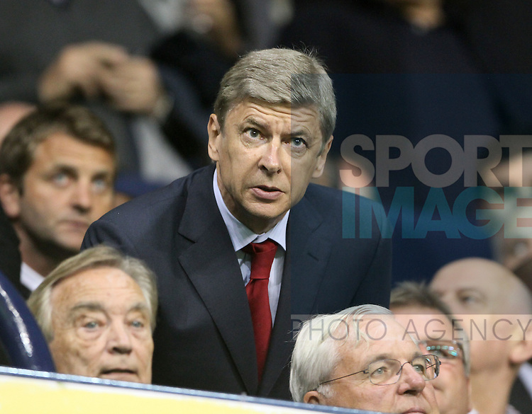 Arsenal's Arsene Wenger watches on from the stand