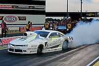 Aug 29, 2014; Clermont, IN, USA; NHRA pro stock driver Shane Tucker gets  sideways on the burnout during qualifying for the US Nationals at Lucas Oil Raceway. Mandatory Credit: Mark J. Rebilas-USA TODAY Sports
