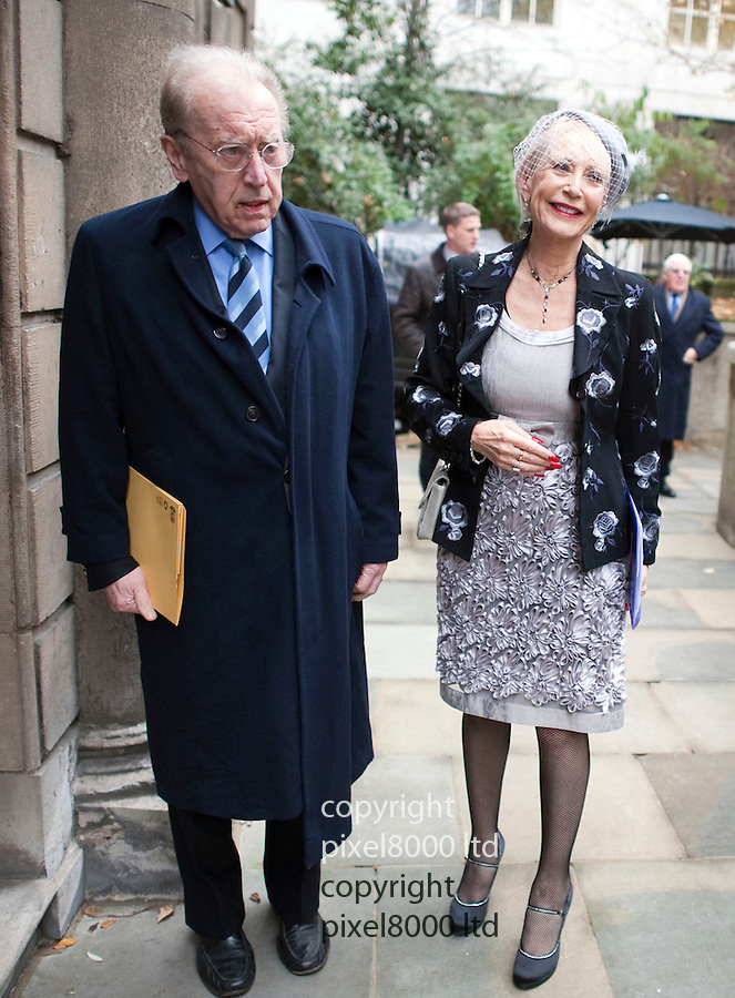 Pics shows: Sir David Frost who died today.<br /> <br /> <br /> seen here art Derek Jameson memorial service at ST Brides with widow Ellen Petrie <br /> <br /> <br /> <br /> Pic by Gavin Rodgers/Pixel 8000 Ltd