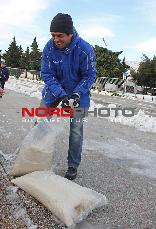 Hrvoje Males, the President of FC Hajduk cleans the remains of snow in front of the Poljud Stadium in Split, February 8, 2012. The heavy snow storm that hit the city during the weekend has caused significant problems in traffic and has blocked the city for two days. Over 30 cm of snow that have fallen on the city is the biggest amount of snow in the history of Split. <br /> <br /> Foto &copy;  nph / PIXSELL / Ivana Ivanovic