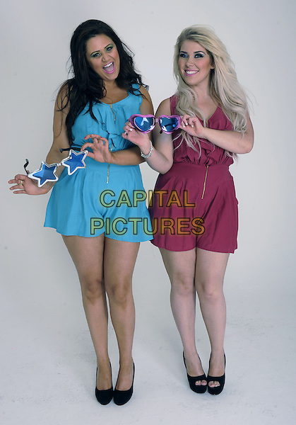 '2 Shoes' duo Lucy Texeira & Charley Bird, London, .August 30th, 2012.**Exclusive. Double fees apply.**.studio x factor full length blue pink playsuit smiling black shoes sunglasses shades .CAP/FIN.©Steve Finn/Capital Pictures.