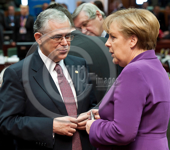 Brussels-Belgium - December 09, 2011 -- European Council, EU-summit during Polish EU-Presidency; here, Lukas PAPADEMOS (le), Prime Minister of Greece, with Angela MERKEL (ri), Federal Chancellor of Germany -- Photo: Horst Wagner / eup-images