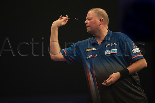 22.12.2014.  London, England.  William Hill PDC World Darts Championship.  Raymond van Barneveld (14) [NED] in action during his game with Rowby-John Rodriguez [AUT].  Barneveld won 3-0.