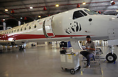 Sao Paulo, Brazil. Sichuan Airlines ERJ 145 aircraft in hangar at Embraer factory.