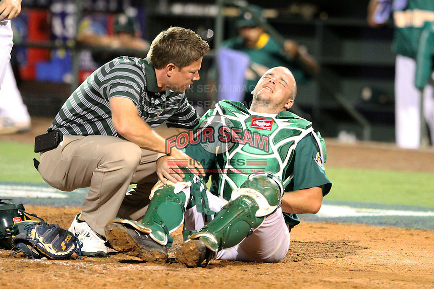 Kyle Botha #4 of Team South Africa gets checked after getting hit with a fowl ball during a game against Team Israel at Roger Dean Stadium on September 19, 2012 in Jupiter, Florida. Team Isreal defeated Team South Africa 7-3.  (Stacy Jo Grant/Four Seam Images).