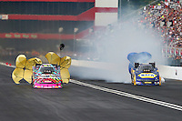 Jun 20, 2015; Bristol, TN, USA; NHRA funny car driver Courtney Force (left) slows alongside Ron Capps during qualifying for the Thunder Valley Nationals at Bristol Dragway. Mandatory Credit: Mark J. Rebilas-