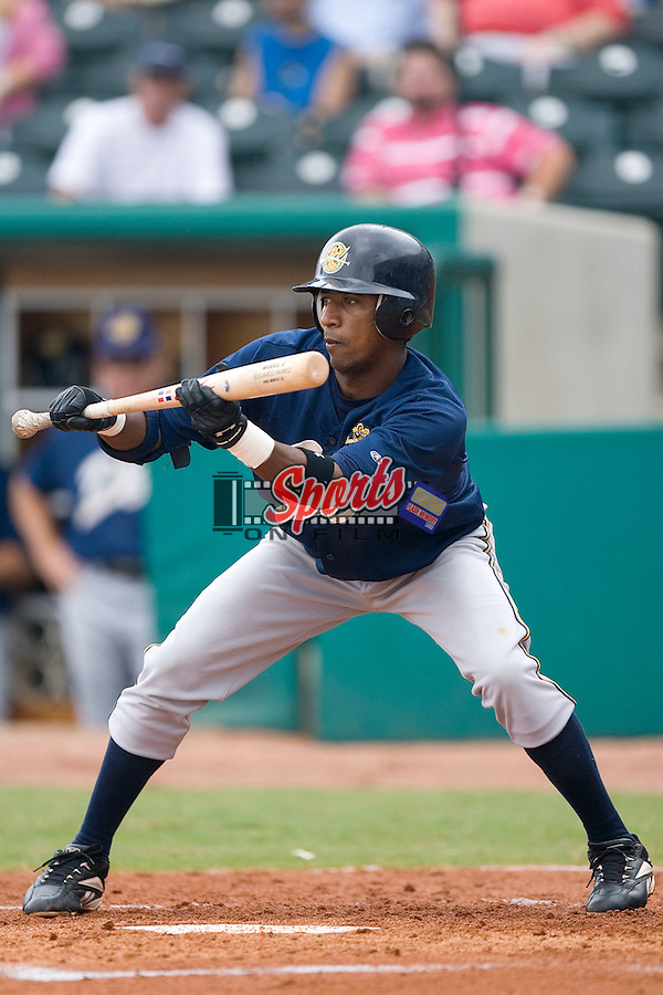 Charleston RiverDogs shortstop Eduardo Nunez squares to bunt versus the Greensboro Grasshoppers at First Horizon Park in Greensboro, NC, Wednesday, August 9, 2006.