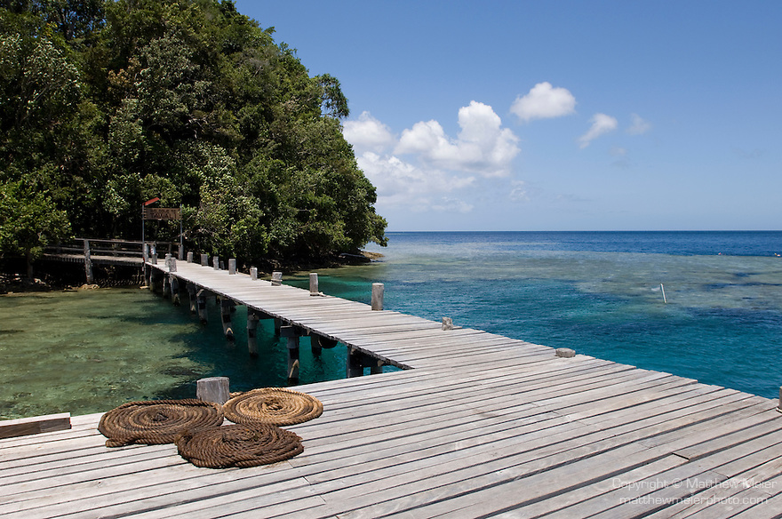 Milne Bay, Papua New Guinea; Tawali Resort, rope coiled on the main dock, with the house reef in the background , Copyright © Matthew Meier, matthewmeierphoto.com