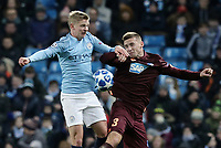 Manchester City's Oleksandr Zinchenko vies for possession with 1899 Hoffenheim's Pavel Kaderabek<br /> <br /> Photographer Rich Linley/CameraSport<br /> <br /> UEFA Champions League Group F - Manchester City v TSG 1899 Hoffenheim - Wednesday 12th December 2018 - The Etihad - Manchester<br />  <br /> World Copyright © 2018 CameraSport. All rights reserved. 43 Linden Ave. Countesthorpe. Leicester. England. LE8 5PG - Tel: +44 (0) 116 277 4147 - admin@camerasport.com - www.camerasport.com