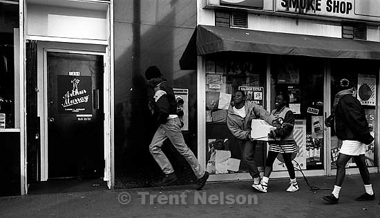 Looters carrying stolen goods from Radio Shack during riots following the Rodney King verdict<br />